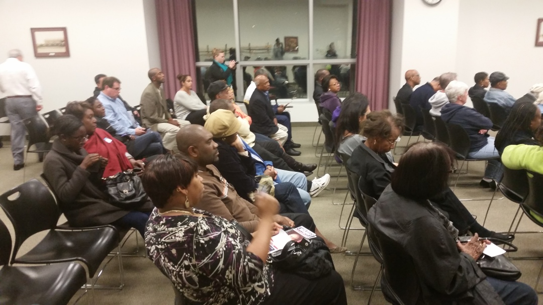 An audience of Elmont residents and surrounding community members listen carefully to candidates before making a vote in November.