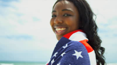 stock-footage-ethnic-girl-wrapped-in-towel-american-flag
