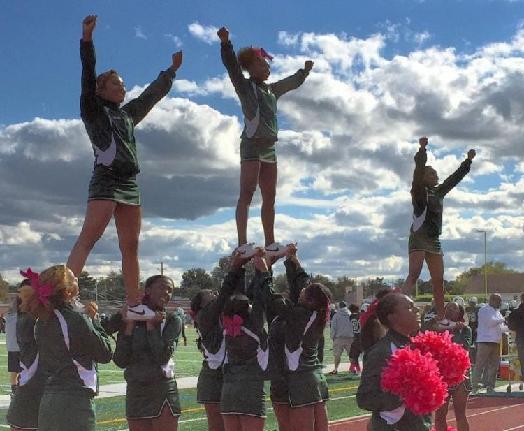 The Elmont Memorial High School cheerleaders perform at halftime during the school's 2015 Homecoming Day game on Oct. 17, 2015. (Photo by Heather Doyle, Newsday.)